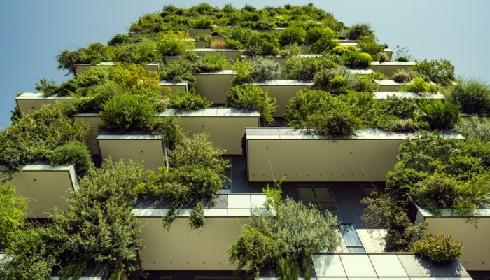 Milan, Italy, High-rise house with trees, shrubs and hedges in the city of Milan.